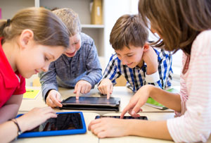 kids using tablets in class