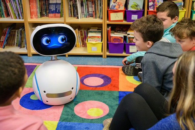 Fifth graders at the College School, located on the University of Delaware's Newark campus, watch Zenbo the social robot describe good habits for using safe computing.