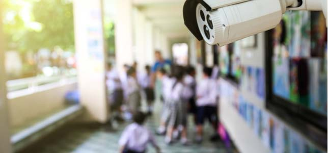school security cameras, smart lighting and HVAC are all part of the Internet of Things