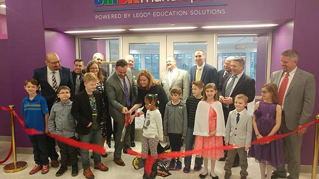 Montour teachers, administrators and students at the Feb. 22 ribbon-cutting ceremony for the new Brick Makerspace powered by Lego Education. Christopher Stone, Montour School District superintendent, and Silver McDonald, head of Lego Education North America, hold the scissors.