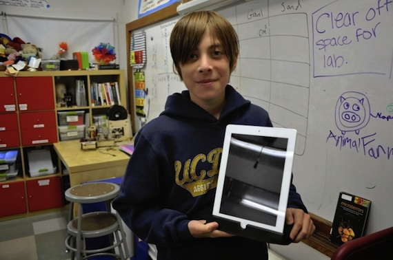 Student Cole Compton holds a partially printed iPad stand. (Photo courtesy of Christine Mytko.)