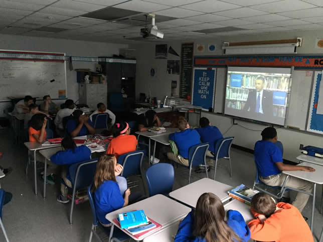 Students participate in a virtual field trip from Discover Education featuring President Obama.