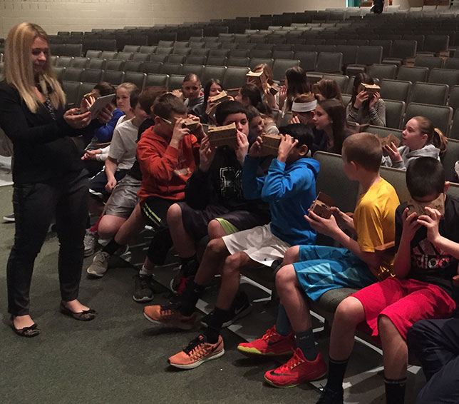 Students take a Google Expedition as part of their education
