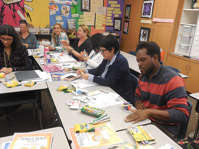 Teachers from Burbank Elementary School in San Diego, California (a 2014-2015 Champion Creatively Alive Children grant winning school), make their thinking visible during a Crayola professional development session.