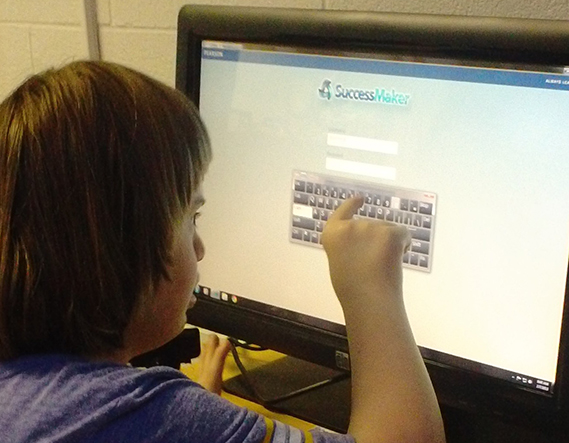 Student at a touchscreen computer in a multimodal communications classroom