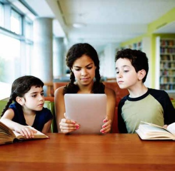3 students viewing an e book on an iPad.