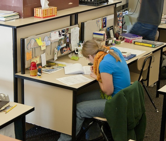 student at her desk in one of the pod workstations