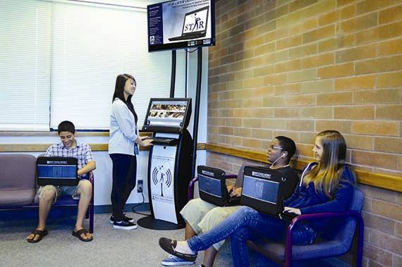 students at kent school district washington using internet kiosks after school