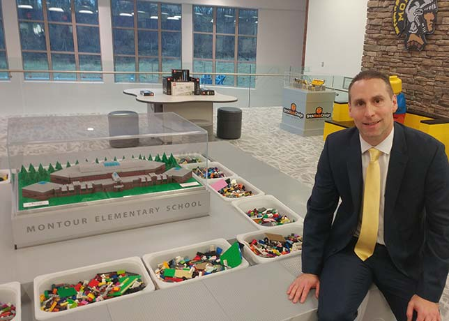 Montour Elementary Co-Principal Jason Burik is also an accomplished Lego artist. He's pictured here at the Brick Makerspace's central feature: the Creation Station.