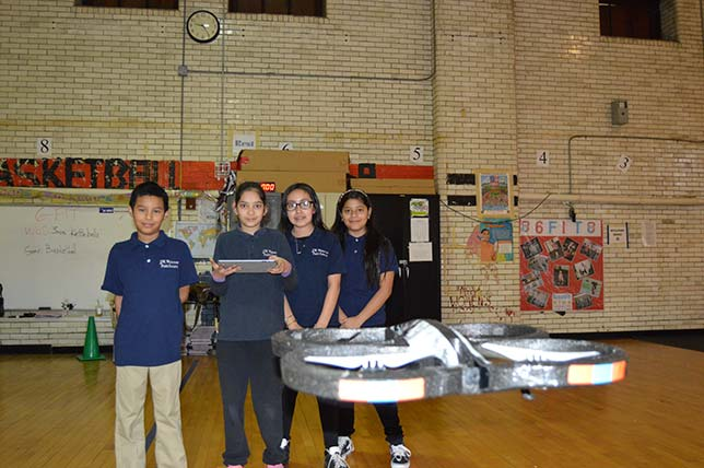 Jersey City Public Schools students fly drones indoors.