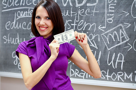 Teacher smiling, holding money
