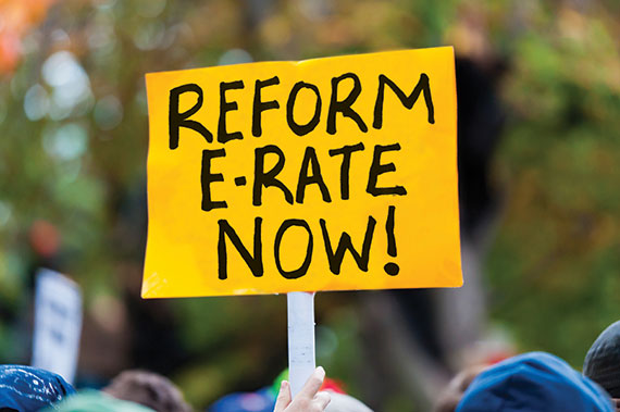 Printed sign: Reform e-rate now!