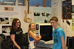 From left, Colfax High School students Autumn Turner, Hailey Elias and Alec Cobabe have invented a ski sensor and are learning product design as part of a community college STEM initiative.