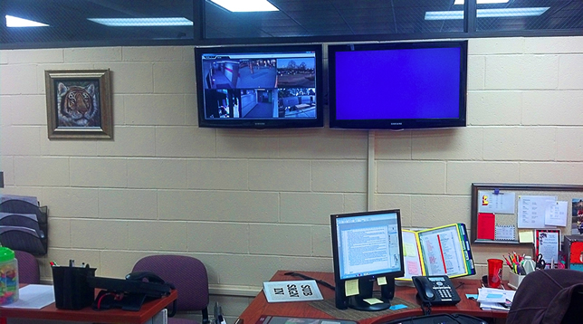 The administrative offices rotate video feeds on publicly viewable displays.