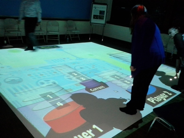 SMALLab projects a computer display that students can directly interact with.