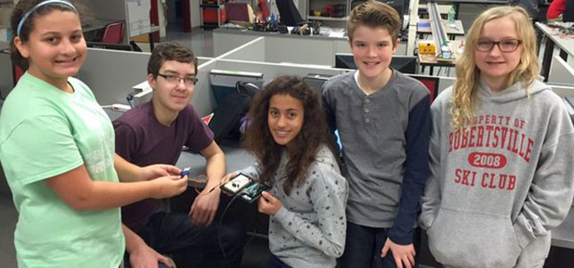 Robertsville Middle School students work with Arduinos for a cubesat project.